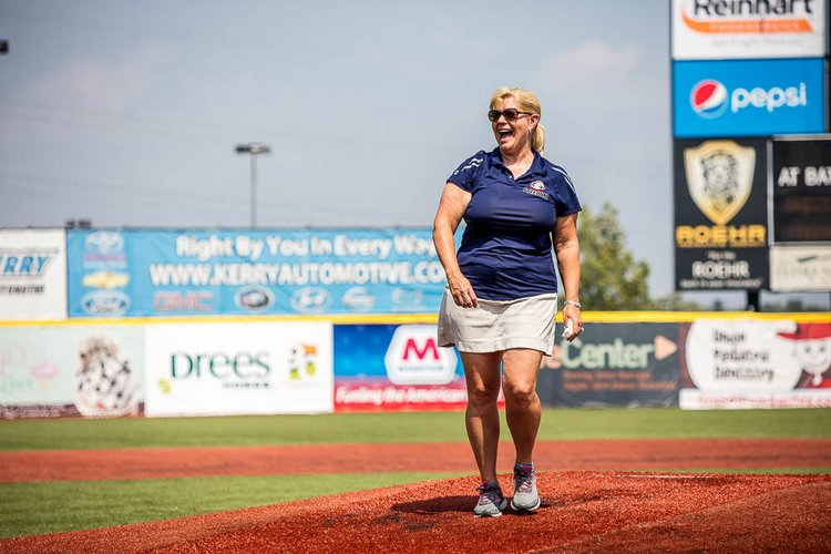 Florence Freedom owner and assistant general manager of operations Kim Brown throws out the first pitch before a game.