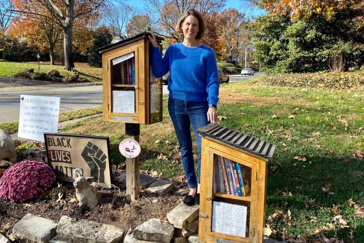 Maggie Gieseke shows off her libraries in Hyde Park: The Big Pig Little Free Library for adults and The Big Pig Little Free Children's Library with books only for kids. She's committed to stocking books by diverse authors. Charter #900