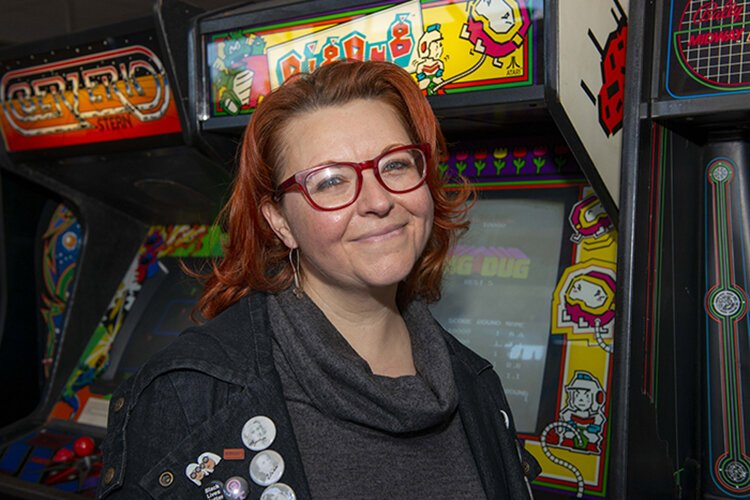 Leslie Rich, Westwood Works director, at the soon-to-be-opened retro arcade she and her husband own.