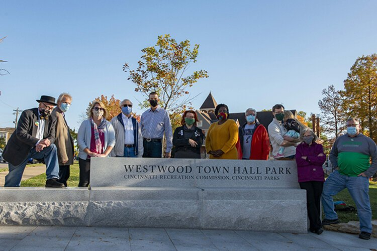 The renovated Westwood Town Hall Park includes a new playground, a plaza and community gathering space, new landscaping, terraced seating, and a dog park.