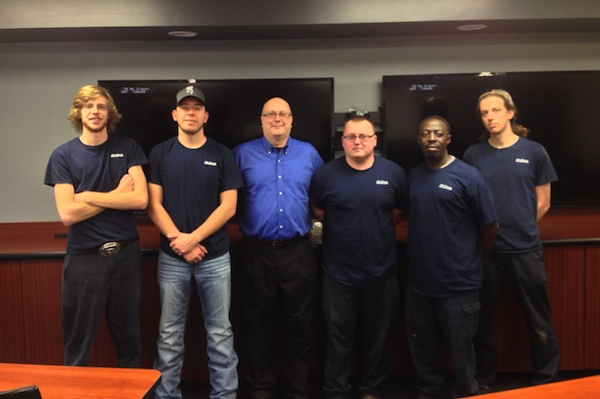 Mubea's first class of apprentices with the company's Drew Farris (light blue shirt)